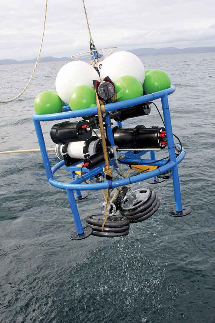 An underwater camera being retrieved.