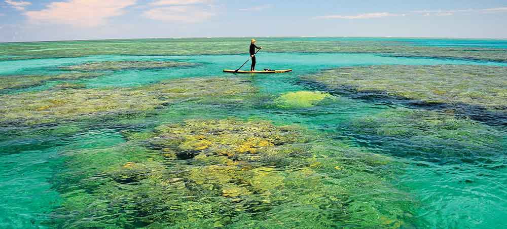 Great Barrier Reef with a paddler in background.