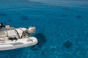 Inflatable dinghy on clear water.
